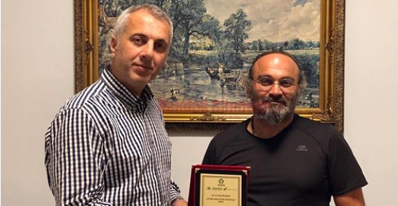 MHP İlçe Başkanı Babaoğlu Baycan'ı Kutladı